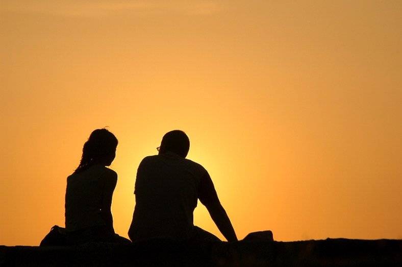bigstock_Silhouetted_loving_couple_at_s_25932527